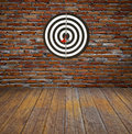 Dartboard on brick wall Royalty Free Stock Photo