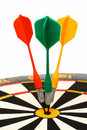 Dartboard with darts in aim Stock Images