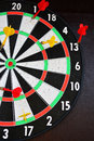 Dartboard with darts yellow and red on Stock Photos