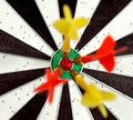 Dartboard with darts in yellow and red colors are on the target of a Royalty Free Stock Photos