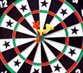 Dartboard with darts in yellow and red colors are on the target of a Royalty Free Stock Photography