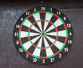 Dartboard hanging on wooden wall Royalty Free Stock Photo