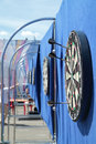 Dartboard with javelins on blue wall on street Royalty Free Stock Photo
