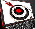 Dartboard on laptop shows effectiveness and accuracy Royalty Free Stock Photos