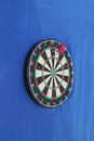 Dartboard with numbers and with three javelins Royalty Free Stock Photo