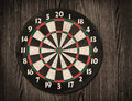 Dartboard on old wooden wall. Royalty Free Stock Photo