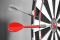 Dartboard with red darts on gray background Royalty Free Stock Photography