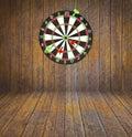 Dartboard on room wood background Stock Images