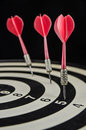 Dartboard tree red darts on Stock Images