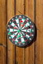 Dartboard on wood wall Royalty Free Stock Photography