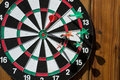 Dartboard on wood wall Stock Photography