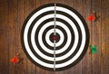 Dartboard on wood wall (miss darts) Stock Photos