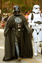 Darth Vader And Stormtrooper Walk In Halloween Parade Stock Images
