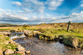 Dartmoor cross an ancient stone at windy post on in devon where the beckamoor brook crosses the grimstone and sortridge leat also Royalty Free Stock Image