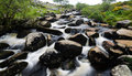 Dartmoor river flowing through in south england Stock Images