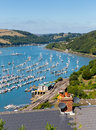 Dartmouth town and river dart harbour devon england with boats yachts railway station in foreground Stock Photo