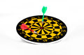 Darts and arrows on a white background closeup Royalty Free Stock Images
