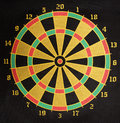 Darts board yellow green red and black Stock Photos
