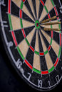 Darts in the center of a dartboard three Royalty Free Stock Photos