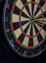 Darts in the center of a dartboard three Stock Photography