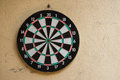 Darts game of target on wall in garden Royalty Free Stock Image