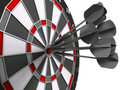 Darts hitting bulls eye Stock Image