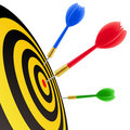 Darts hitting the target Royalty Free Stock Photos