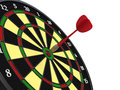 Darts on target arrow in bullseye of dartsboard Royalty Free Stock Image