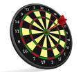 Darts on target arrow in bullseye of dartsboard Stock Photography