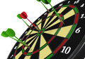 Darts on target arrow ib bullseye of dartsboard Royalty Free Stock Images