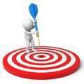 Darts and target a people is standing on the dartboard with a dart Royalty Free Stock Image