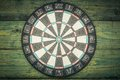 Darts on a wall from green boards toned in warm colors Royalty Free Stock Photography
