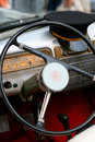 Dashboard of old car with steering wheel and cap of driver Royalty Free Stock Photo