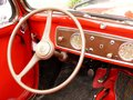 stock image of  Dashboard with tools and steering wheel of a vintage car