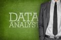 Data analyst on blackboard with businessman in a suit side Stock Photos