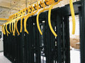 Data center rack and stacks a typical setup of communication racks in a datacenter filled with switches routers that keep all the Royalty Free Stock Images