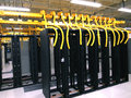 Data center rack and stacks a typical setup of communication racks in a datacenter filled with switches routers that keep all the Stock Photos