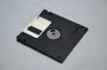 Data diskette old black magnetic on grey background Stock Image