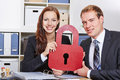 Data security in business office with two people holding a lock Royalty Free Stock Images