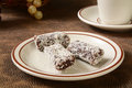 Date bars gourmet with coconut shavings and a cup of coffee Royalty Free Stock Images