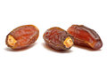 Date fruits isolated close up on white under studio lighting Royalty Free Stock Image