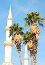 Date Palm Trees and Beautiful Minaret Royalty Free Stock Photo