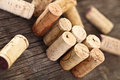 Dated wine bottle corks wooden background close up Royalty Free Stock Images