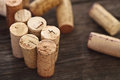 Dated wine bottle corks wooden background close up Stock Photo