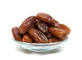 Dates in a glass bowl on a white background juicy figs isolated close up horizontal photo Royalty Free Stock Images