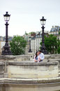 Dating couple is kissing gently in Paris Royalty Free Stock Photography