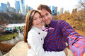 Dating couple in love central park new york city young happy taking self portrait selfie photo late fall early winter with Stock Photo