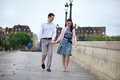 Dating couple in Paris walking hand in hand