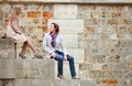 Dating couple sitting on the seine embankment in paris Stock Photos