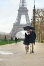 Dating couple under the rain in paris Royalty Free Stock Images